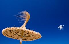 Little white fluffy cloud (The Green Album) Tags: blue sky cloud sun white hot beach umbrella spain mediterranean straw fluffy sunny clear shade tiny mallorca majorca mfcc abigfave