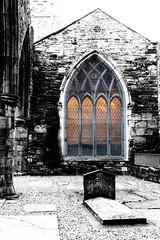 Shine a light on Me (beelzebub2011) Tags: ireland dublin church grave stainedglass bw monochrome selectivecolor staudoenschurch