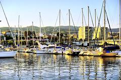 When the sun paints (Fnikos) Tags: port sun light sunlight sky skyline serene sea city architecture water waterfront reflection boat vehicle outdoor