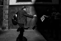 Relay Race. (instagram.com/the_big_smoke_/) Tags: britain bw blackandwhite central city centre candid composition capture contrast compo camden london street streetphotography streetscene streetphoto streets shadows sunlight urban uk newspaper news olympics mono monochrome man moment england people peoplewatching photography perspective photo portrait pavement robmchale