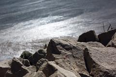 (decemberGirl.) Tags: rocks water river bokeh glitter 50mm