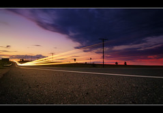 Lights (TylerPPorter) Tags: longexposure sunset foothills motion landscape interesting movement colorado colorful vibrant sony awesome scenic boulder vista lighttrails alpha frontrange carlights mesa flatirons lowperspective timedexposure trailhead a55 tylerporter