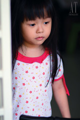 IMG_7831 (Alphone Tea) Tags: door family light red portrait favorite white black blur color girl beautiful childhood kids composition contrast canon children photography photo singapore colorful asia image little bokeh sister side staring 85 2012 1755 handhold 60d