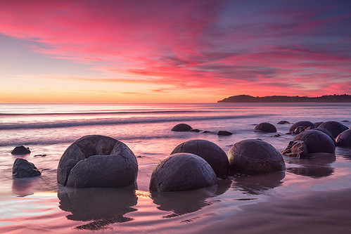 Moeraki sunrise (Luke Tscharke) pink newzealand seascape sunrise geotagged rocks vivid canterbury boulders nz moerakiboulders moeraki eastcoast geo:lat=45345366829685354 geo:lon=17082632182893065