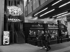 Fourth Street, Louisville Kentucky (Cragin Spring) Tags: city urban bw irish bar pub downtown kentucky ky machine coke louisville cocacola improv fourthstreet louisvillekentucky
