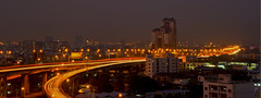 Highway at night @ Bangkok, Thailand (RickyLoca) Tags: city travel bridge blue sunset sky urban orange cloud holiday building green cars tourism colors car skyline architecture modern night clouds turn dark corporate evening office timelapse high highway asia long exposure commerce cityscape shadows skyscrapers south twin center scene structure east business destination hd inspirational financial development develop rickyloca