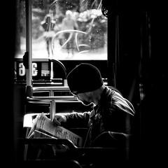 the light at The Edge (. Jianwei .) Tags: light white man black blur bus window sunglasses vancouver newspaper mood dof bokeh candid sony atmosphere stranger pi theedge shining poco 159 a500 kemily 2013syzy