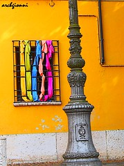 stoffe alla finestra (archgionni) Tags: street house muro window lamp yellow wall casa strada colours finestra giallo colori lampione stoffe
