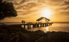 Sunset Light (timcorbin) Tags: sun beach canon pier rocks silhouettes tobago sunet