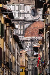 Florence (MikePScott) Tags: camera italy church abbey sign buildings logo lens florence italia cathedral basilica flag banner flags monastery tuscany cupola dome firenze duomo toscana ecclesiastical baptistry builtenvironment architecturalfeatures nikon18200mmf3556 nikond300 featureslandmarks