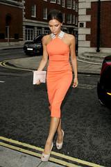 victoria-beckham (tenditrendy) Tags: uk party london walking fulllength tan clutch peeptoe victoriabeckham grb orangedress nudeheels