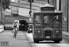 Bicycle vs. Trolley (Ian Sane) Tags: street bridge white black bicycle oregon river portland ian photography cyclists downtown trolley candid 4 images number transit vs mass hawthorne willamette sane