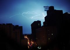 Lightning on Harrison (aReasontoHope) Tags: city shadow sky urban chicago rain weather architecture night buildings dark illinois downtown loop menacing lightning southloop shilouette areasontohope