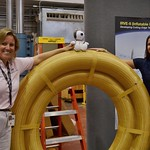 Mary Beth Wusk and Amanda Cutright and AstroSnoopy with the IRVE-3
