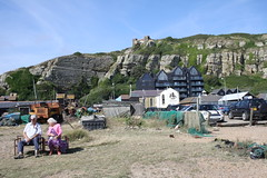 Enjoying a day by the sea (My photos live here) Tags: beach cliffs grass people holidaymakers hastings east sussex england seaside holiday resort canon eos 1000d