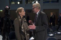 Catharina Elmsäter-Svärd talks with a delegate at the Annual Summit