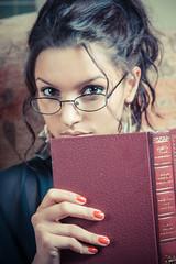 Radha (Roj) Tags: uk portrait woman canon eos glasses book flash models llandudno radha 24105 northwales offcameraflash gogleddcymru canonef24105mmf4lusm 5dmkii welshot