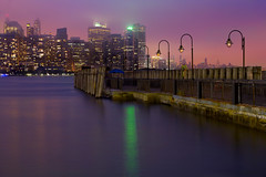 Spring Fog Over Manhattan (SunnyDazzled) Tags: statepark city nyc longexposure pink newyork water weather fog ferry night reflections liberty lights bay wooden spring dock jerseycity colorful glow cityscape purple manhattan hudson sparkling