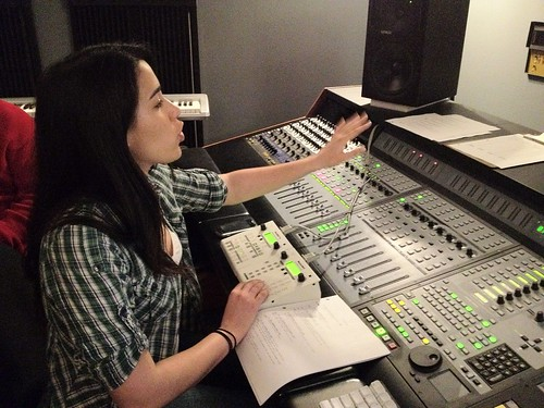 Nadine, a fellow Creative Producing student, directs me from the booth.