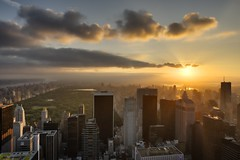 New York City at Sunrise, June 18, 2012 (mudpig) Tags: nyc newyorkcity light cloud newyork reflection skyline sunrise geotagged cityscape centralpark 5thavenue flare upperwestside hudsonriver gothamist goodmorning hdr topoftherock observationdeck bloombergbuilding essexhotel fourseasonshotel solowbuilding mudpig stevekelley avonbuilding stevenkelley