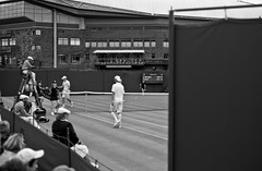 I Only Saw Half a Game (The_Kevster) Tags: tennis wimbledon london tournament grandslam game sport aeltc leica rangefinder leicam9 summicron50mm petzcschner kavcic 2012 grass court net monochrome bw blackandwhite scoreboard umpire player fans crowd wimbledon2012 day1