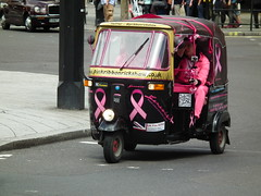 Pink Ribbon Rickshaw (kenjonbro) Tags: auto 2003 uk pink london westminster tricycle trafalgarsquare tuktuk trike ribbon petrol rickshaw charingcross sw1 bajaj 3wheeler kenjonbro fujihs10 173cc hx53aoo pinkribbonrickshaw