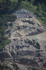 Excavator hard at work on a cliff face, Muzaffarabad city, AJK, Kashmir (Paul Snook) Tags: kashmir ajk muzaffarabad