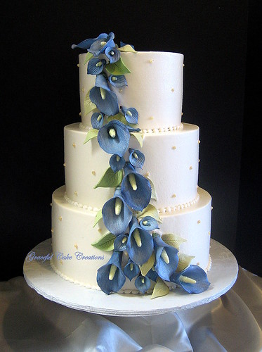 Elegant Ivory Wedding Cake with Blue Calla Lilies - a photo on ...