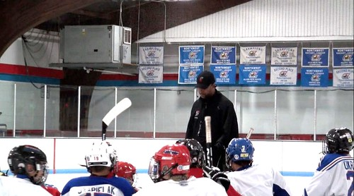 Brad Perry coaching a hockey school in Chicago 22
