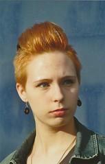 Angela (Irina H.) Tags: flowers red summer portrait berlin june cat 35mm hair ginger holidays bokeh july rockabilly analogue dner irokesenschnitt