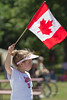 Canada Day Flag Waver (Rock Steady Images) Tags: original summer holiday ontario canada girl youth canon eos daylight flag events places equipment celebrations 7d processing handheld canadianflag canadaday 50views riverdalepark alliston 25views bypaulchambers canonef70200mmf28isiiusm lightroom4 rocksteadyimages
