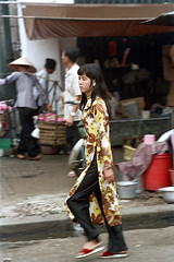 33-539 (ndpa / s. lundeen, archivist) Tags: nick dewolf nickdewolf 33 reel33 color photographbynickdewolf 1970s 1972 fall film 35mm winter 1973 asia vietnam southvietnam vietnamese southvietnamese saigon city citylife street streetlife candid streetphotography people woman youngwoman onfoot clothes clothing women carryingpole shoulderpole carry carrying baskets hat conicalhat traditionalhat sandals