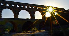 Soleil sur le Pont du Gard (Jean-Paul Granier) Tags: pontdugard aqueduc pont gard bridge pierre sunset soleil starburst