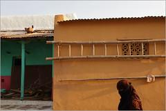 walls, badami (nevil zaveri (thank you for 10 million+ views :)) Tags: zaveri india badami street home house karnataka photography photographer images photos blog stockimages photograph photographs nevil nevilzaveri stock photo architecture people woman women veil ladder wall