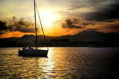 Regresando al atardecer (Fnikos) Tags: sunset boat people evening sea seascape serene sky skyline light water waterfront coast vehicle outdoor