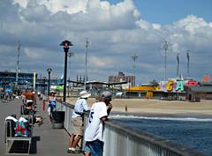 Scene at the Pier (Robert S. Photography) Tags: pier coneyisland scene fishing people sea beach gazing sky cloud summer color scenery sand carousel canon powershot elph160 iso100 brooklyn newyork sept 2016