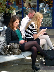The mobil phone world . (Franc Le Blanc .) Tags: girls people bench lumix sitting candid panasonic arena sit streetphoto seated shertogenbosch mobilphones