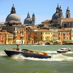 The busy waterways of colorful Venice (Bn) Tags: world life voyage street city trip travel venice houses windows light sea summer people italy music sun color heritage water beauty weather river geotagged boats island mirror islands site ancient topf50 colorful warm europe italia day ride taxi shoreline pedestrian tourist taxis canals unesco clear explore gondola venezia palaces itali veneti vaporetti 50faves geo:lon=12325415 geo:lat=45429059