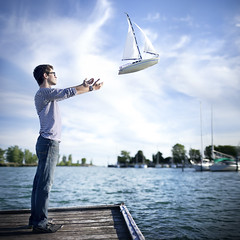 Dreams Setting Sail (Rob Woodcox) Tags: new blue sky canada water shirt clouds sailboat boats waves horizon surreal floating dreams dreamy sailor conceptual striped levitating seniorportrait robwoodcox robwoodcoxphotography