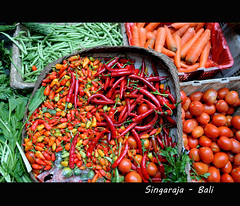 Balinese Peeper (YellowSingle ) Tags: travel bali vegetables indonesia market tomatoes fair peeper trade merchant itinerant balinese singaraja storekeeper