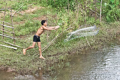 catching fish (steve happ) Tags: fisherman laos tadlo salavan