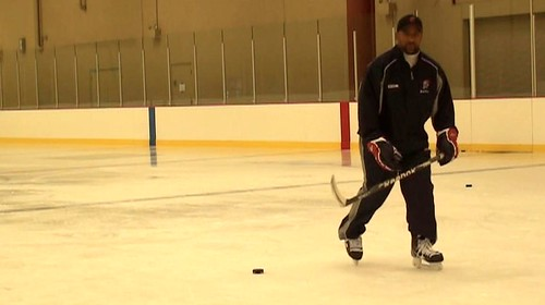 Brad Perry taking a slapshot 1