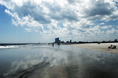 Mirror Image (kayleegould) Tags: ocean sky people reflection beach water skyline clouds buildings reflecting mirror newjersey sand shoreline bluesky reflected reflect shore atlanticcity mirrorimage brigantine bigclouds reflects