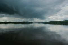Be aware.. (anek07) Tags: storm clouds rain cold ovder moln lake forrest mirror gray blue black white green summerstorm august formation