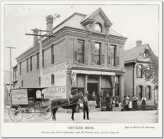 Deuker Brothers Grocery, Richmond, Indiana, 1896 (Hoosier Recollections) Tags: advertising awning boys buildings businesses children clothing fence girls grocery horses houses kids man men people residential signs storefronts streetscene transportation wagons woman women workmen richmond indiana usa waynecounty history hoosierrecollections