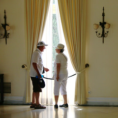 Discussing the curtains (Konstantin Delbrck) Tags: greece light corfu people old palace tourist square reflection yellow