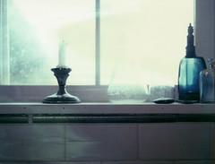 sill (lawatt) Tags: window sill candle kitchen film polaroid 669 crowngraphic