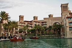 Madinat Jumeirah canal (sonofwalrus) Tags: canon eos7d slr uae unitedarabemirates  dubai madinatjumeirah canal boat building architecture water trees palmtrees middleeast windtowers