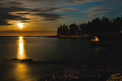 Spring Moonlight - in explore (SunnyDazzled) Tags: ocean longexposure red sea moon lighthouse seascape nature night landscape harbor spring maine atlantic moonlight seashore barharbor eastcoast winterharbor eggrock balancerock