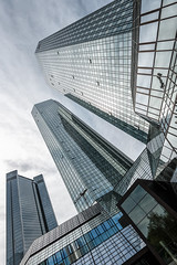 Looming Giants (Philipp Klinger Photography) Tags: windows sky urban tower window glass lines architecture facade skyscraper reflections germany deutschland nikon europa europe hessen geometry frankfurt shapes bank db highrise architektur deutschebank financial philipp glas frankfurtammain scraper fassade finance hochhaus deutsche d800 hesse ffm mainhattan trianon klinger